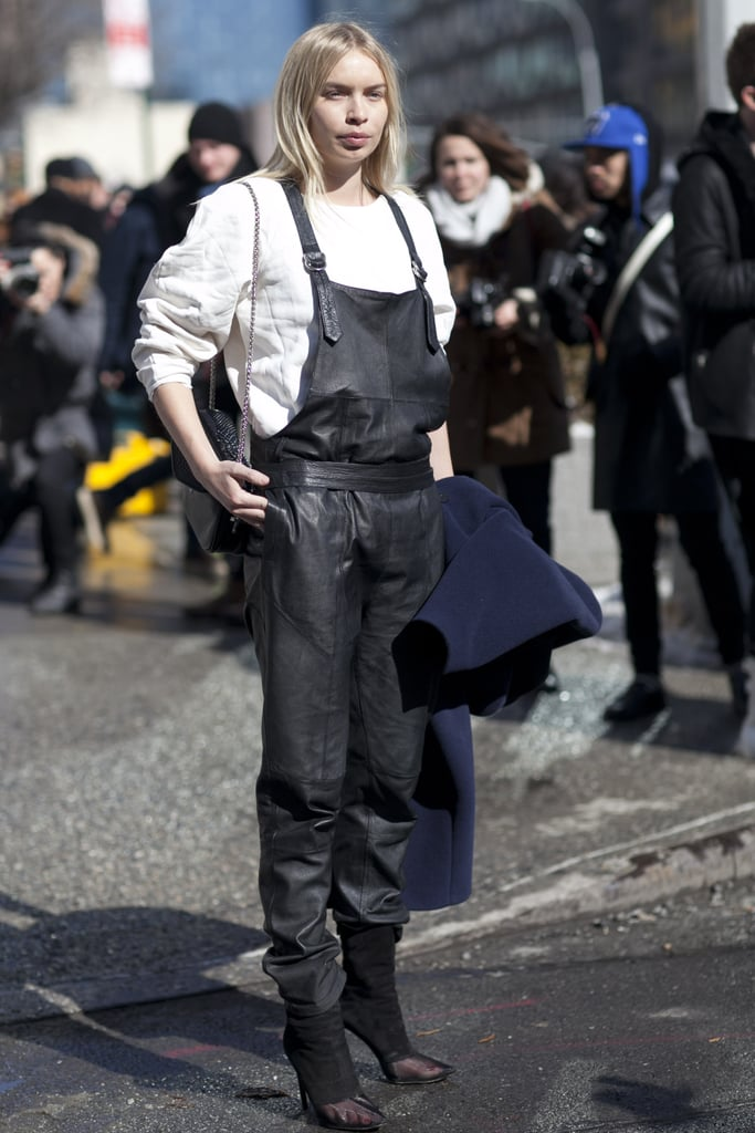 We've been waiting to see these leather overalls in action; this show-goer gave hers a minimalist finish with a sweatshirt and sheer black booties.