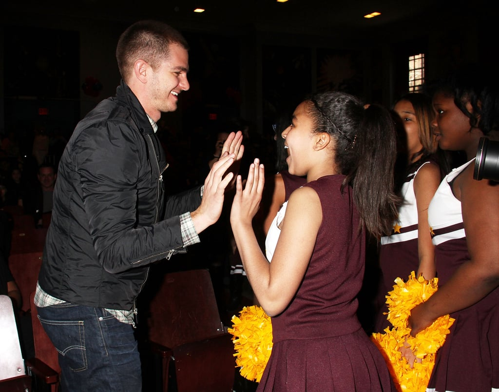 Andrew high-fived a group of cheerleaders at the Be Amazing Volunteer Day in NYC in April 2014.
