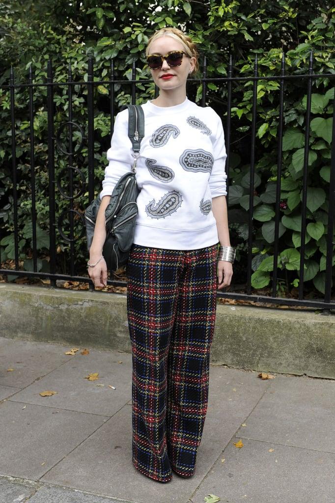 This street-cool mix got its statement power via a paisley print sweatshirt and wide-leg plaid pants.