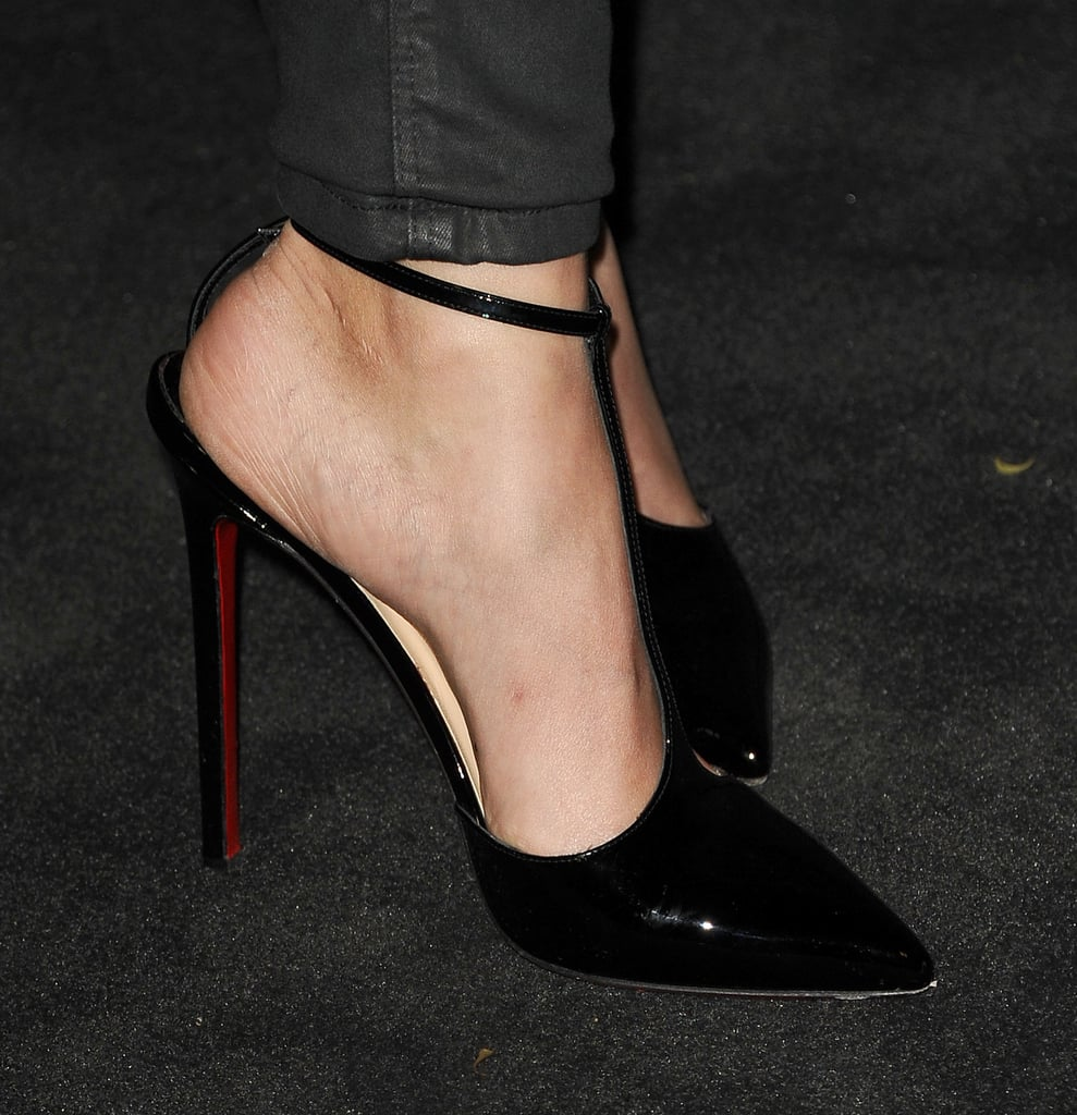 At the Chanel party, Alicia Vikander wore Christian Louboutin T-strap pumps with her laid-back look.