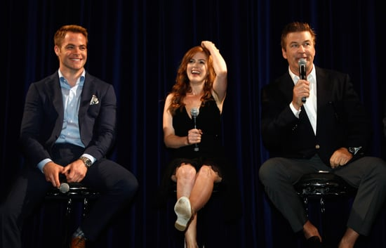 Isla Fisher kicked up her heels during one of Alec Baldwin's answers.
