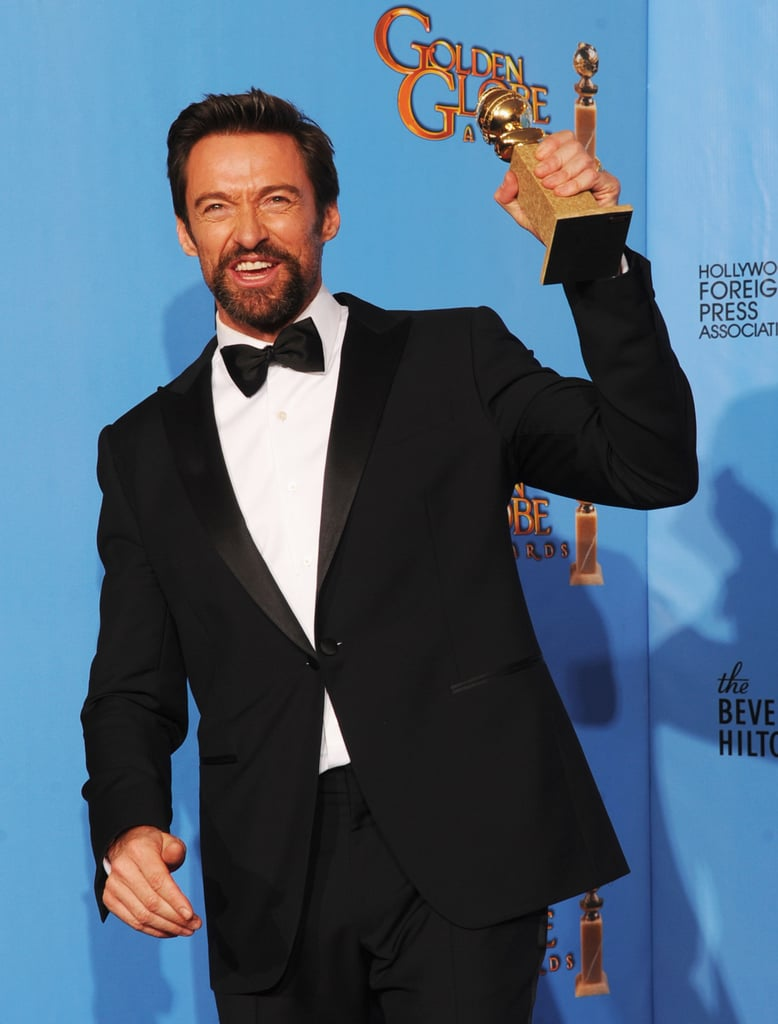 Hugh Jackman held his Golden Globe while speaking to reporters in the press room.