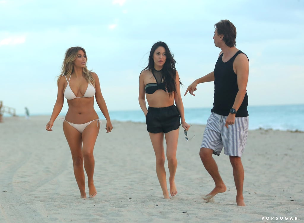 Kim and her friends walked along the beach.