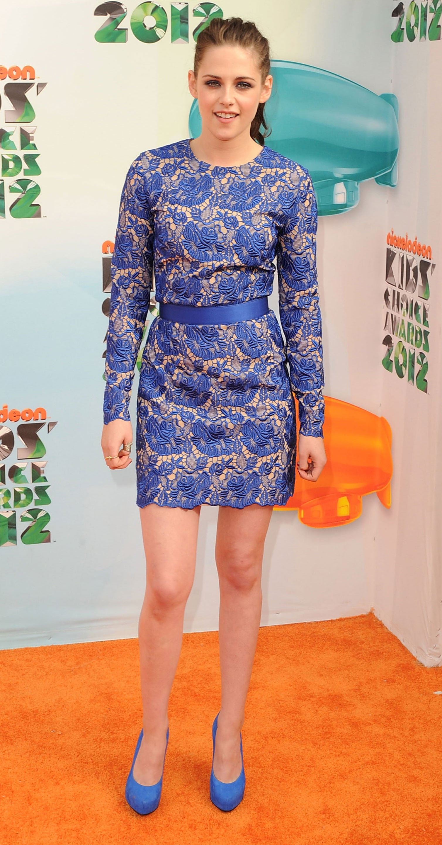 The brunette beauty wore a feminine blue lace Stella McCartney mini with matching suede pumps for the Kids' Choice Awards in March 2012.
