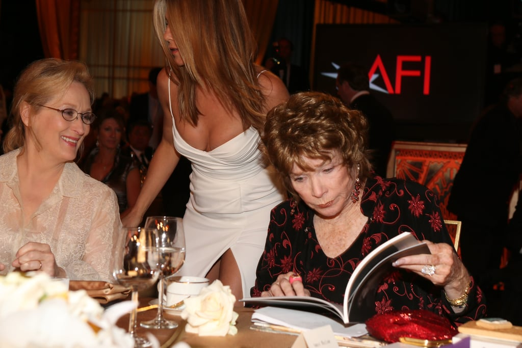 Jennifer Aniston wore Burberry and chatted with Meryl Streep and Shirley MacLaine.