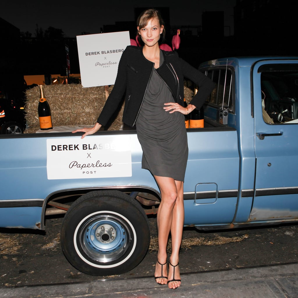 Karlie Kloss was on hand to fete Paperless Post's Derek Blasberg collection with hot wings and champagne at Hogs & Heifers.