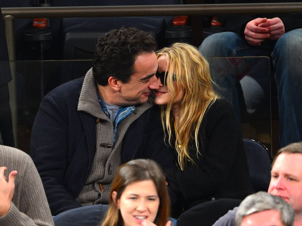 Mary-Kate Olsen and boyfriend Olivier Sarkozy kissed during the game.