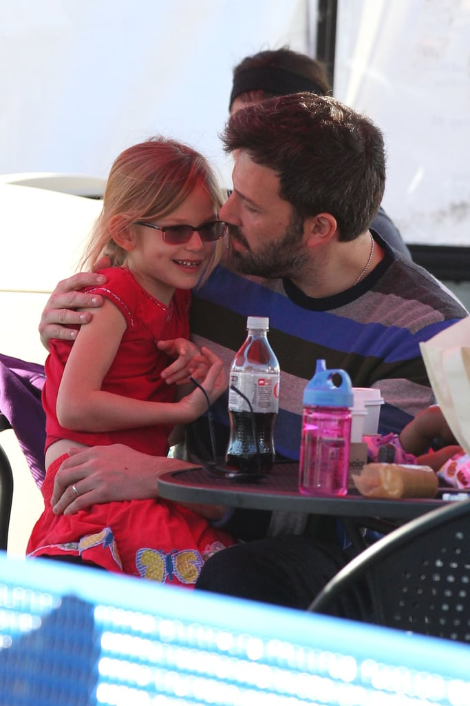 Ben Affleck cuddled with Violet next to the ice.