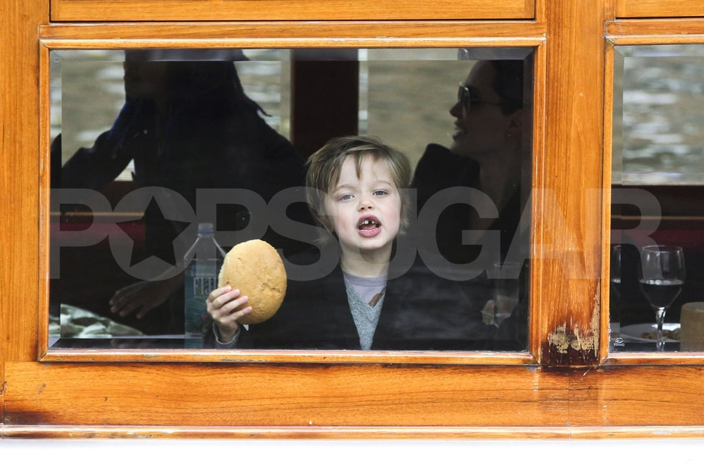 Shiloh Jolie-Pitt played with a piece of bread on a canal boat.