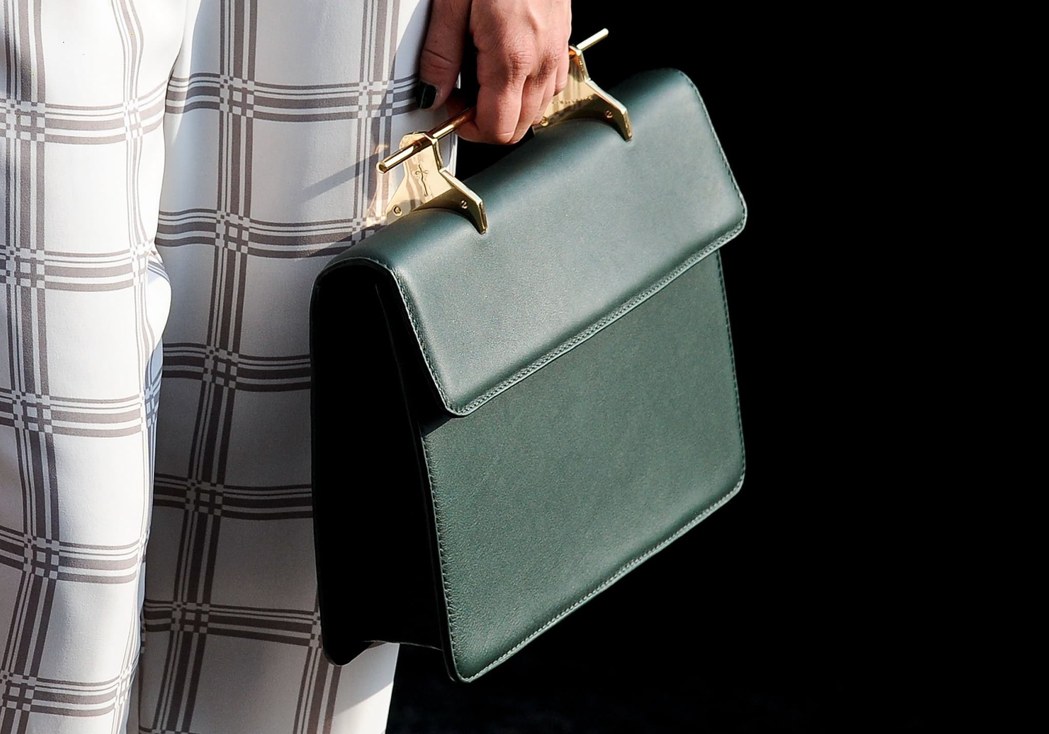 Unique top handle meets classic handbag for a truly covetable design.