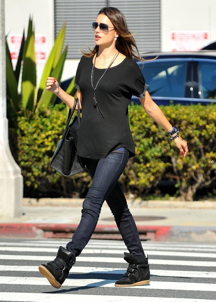 Alessandra Ambrosio paired her high-top black Isabel Marant sneakers with skinny jeans and a black tee by Whetherly.