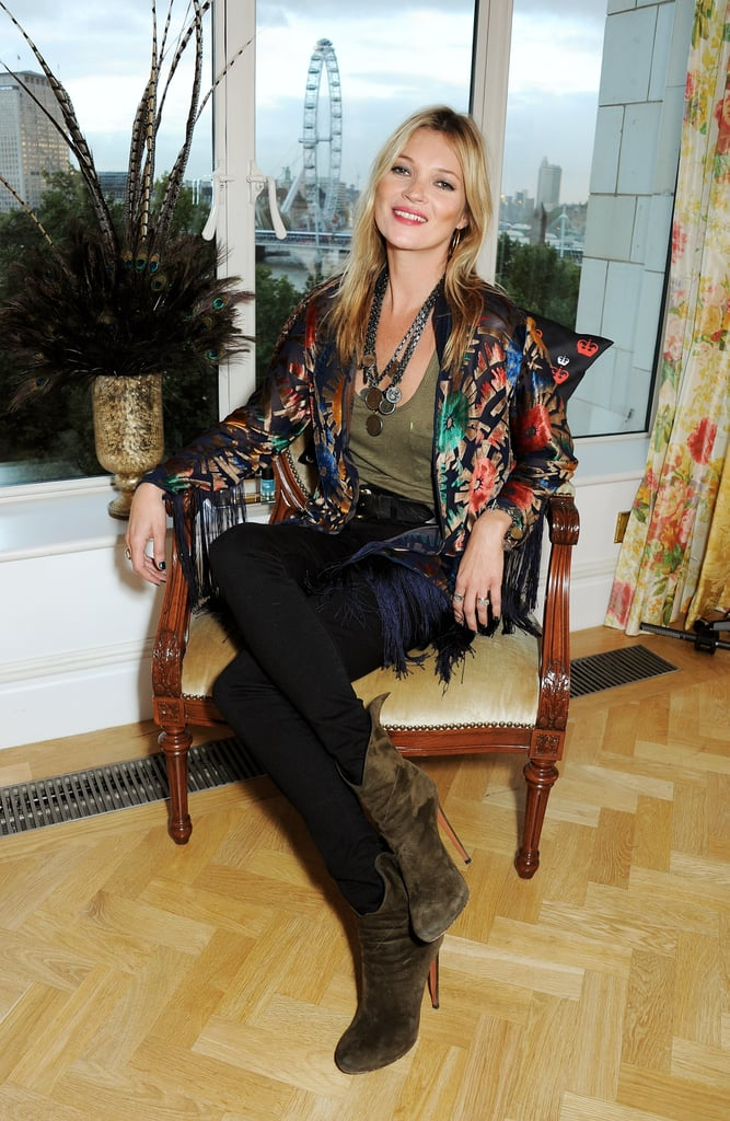 Kate Moss smiled for cameras at the Rimmel London event.
