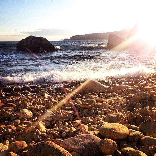 We caught this sunset snap of the waves crashing against a rocky beach. Heavenly!