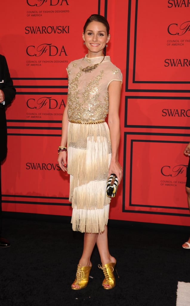 Olivia Palermo went the golden route, teaming this embellished Dennis Basso flapper frockback with her trusty gold lace-up heels.