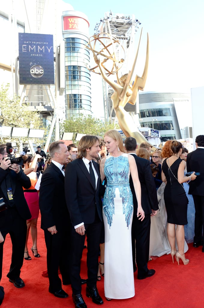 Nicole Kidman left Sunday and Faith home to wow the crowd in Antonio Berardi's white gown with blue sparkly detailing.