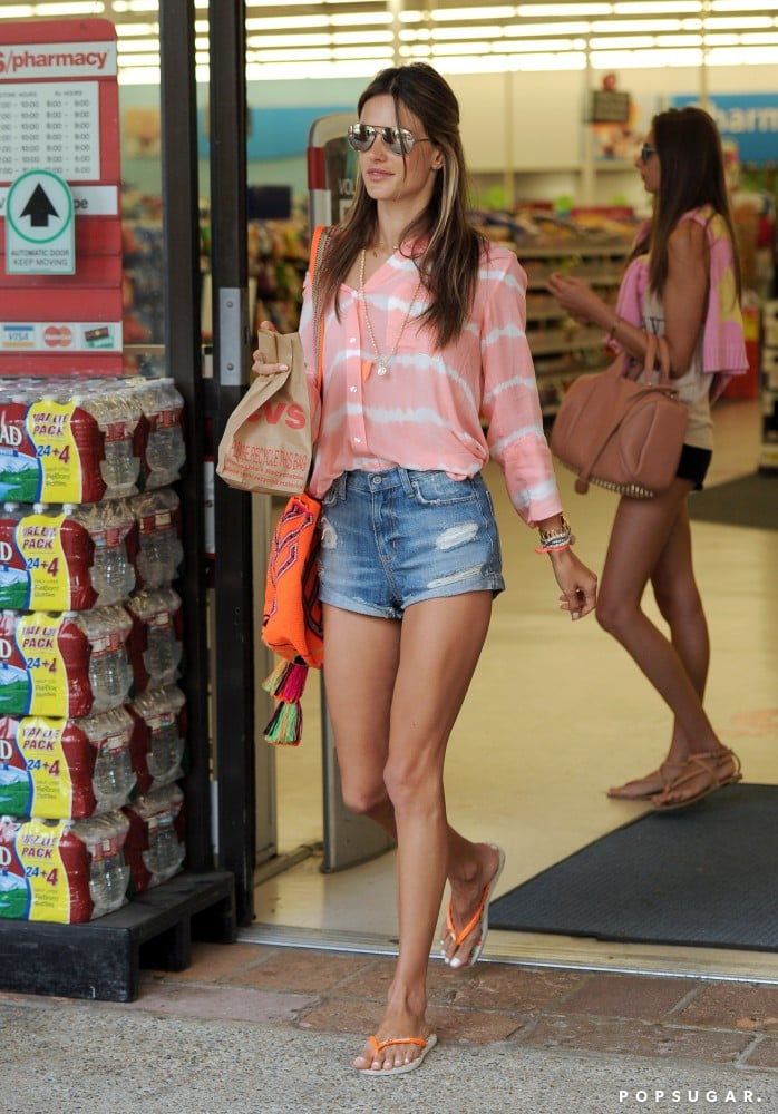 The Bella Dahl coral tie-dye blouse ($127) Alessandra Ambrosio tucked into her distressed denim shorts lent her look a bohemian spin.