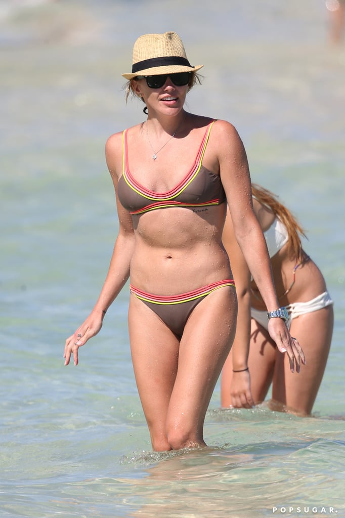 In May 2016, Katie Cassidy showed off her killer abs while wading in the water in Miami.