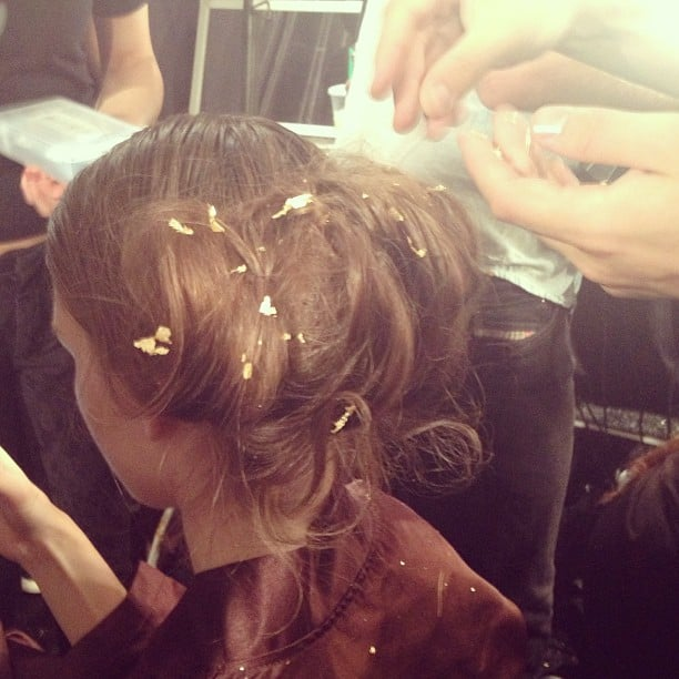 To mimic the appearance of fairy dust, every model got a dash of gold foil in the hair at Lela Rose.