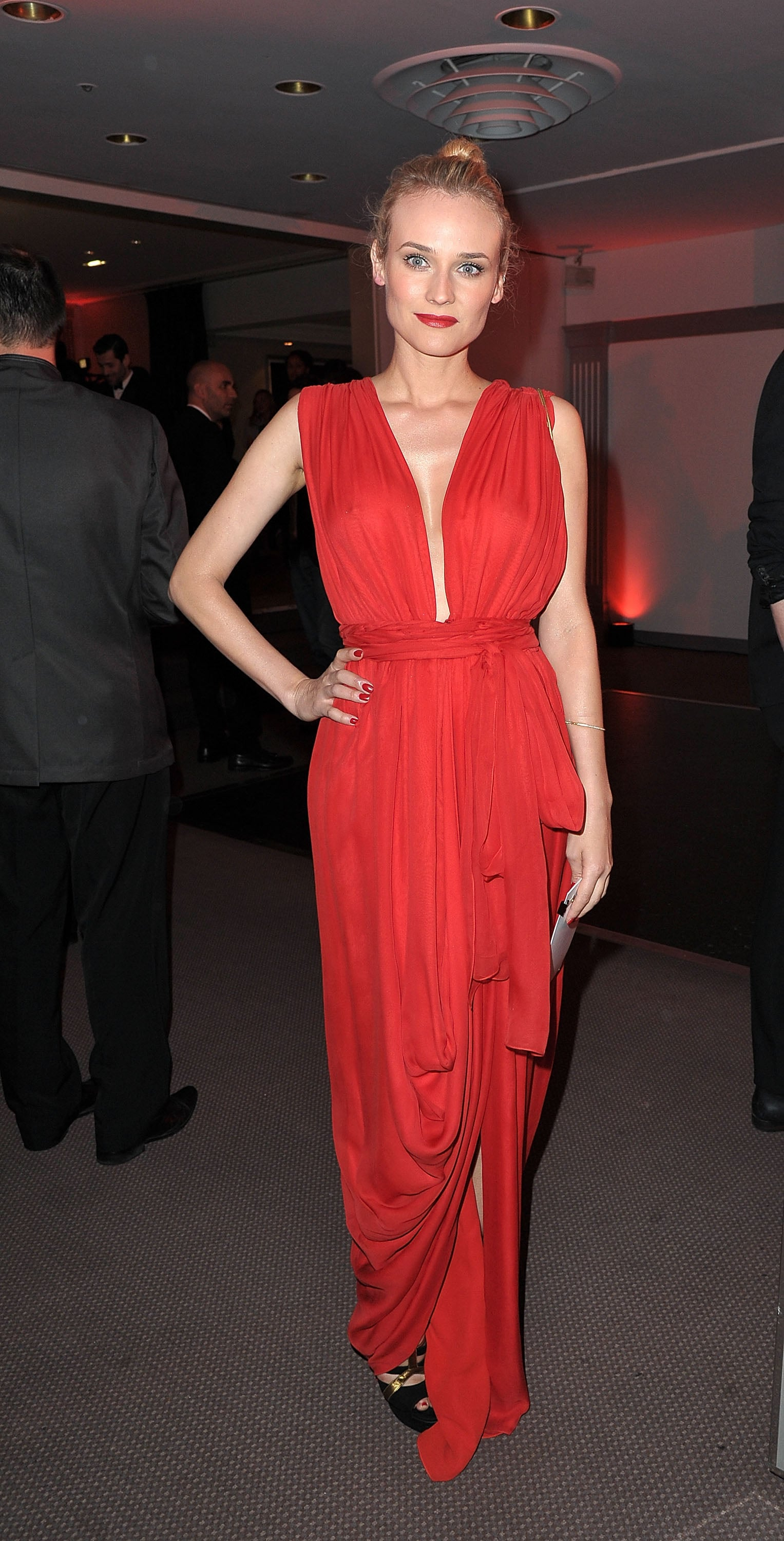 Veering away from her neutral palette, she wore gorgeous red YSL — and a rouge lip to match — at the 2011 amfAR Inspiration Gala.