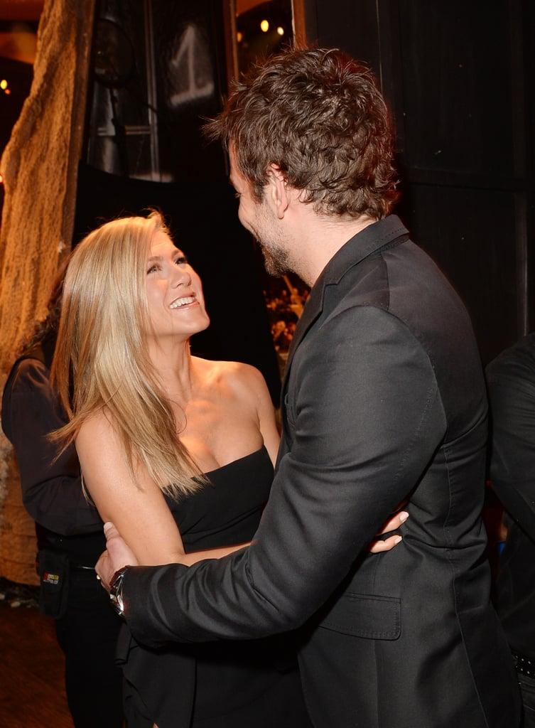 Jennifer Aniston hugged Bradley Cooper.