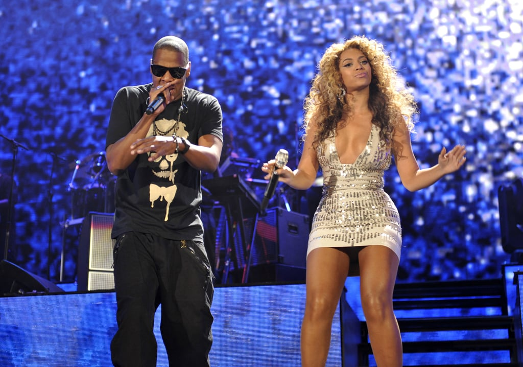 The duo performed on stage together in New York in 2010 — Jay Z kept it edgy in a black printed tee and Beyoncé took the stage in a metallic minidress.