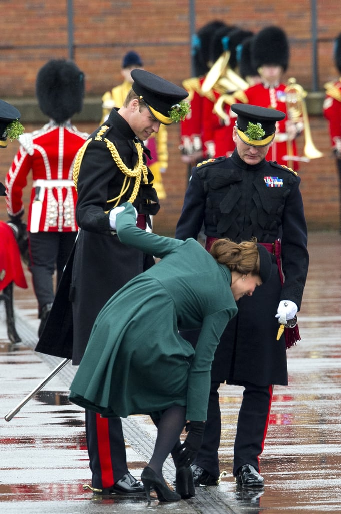 Prince William gave Kate Middleton a hand after she got her heel stuck in grating while taking part at the St. Patrick's Day parade at the Aldershot Barracks in March 2013.