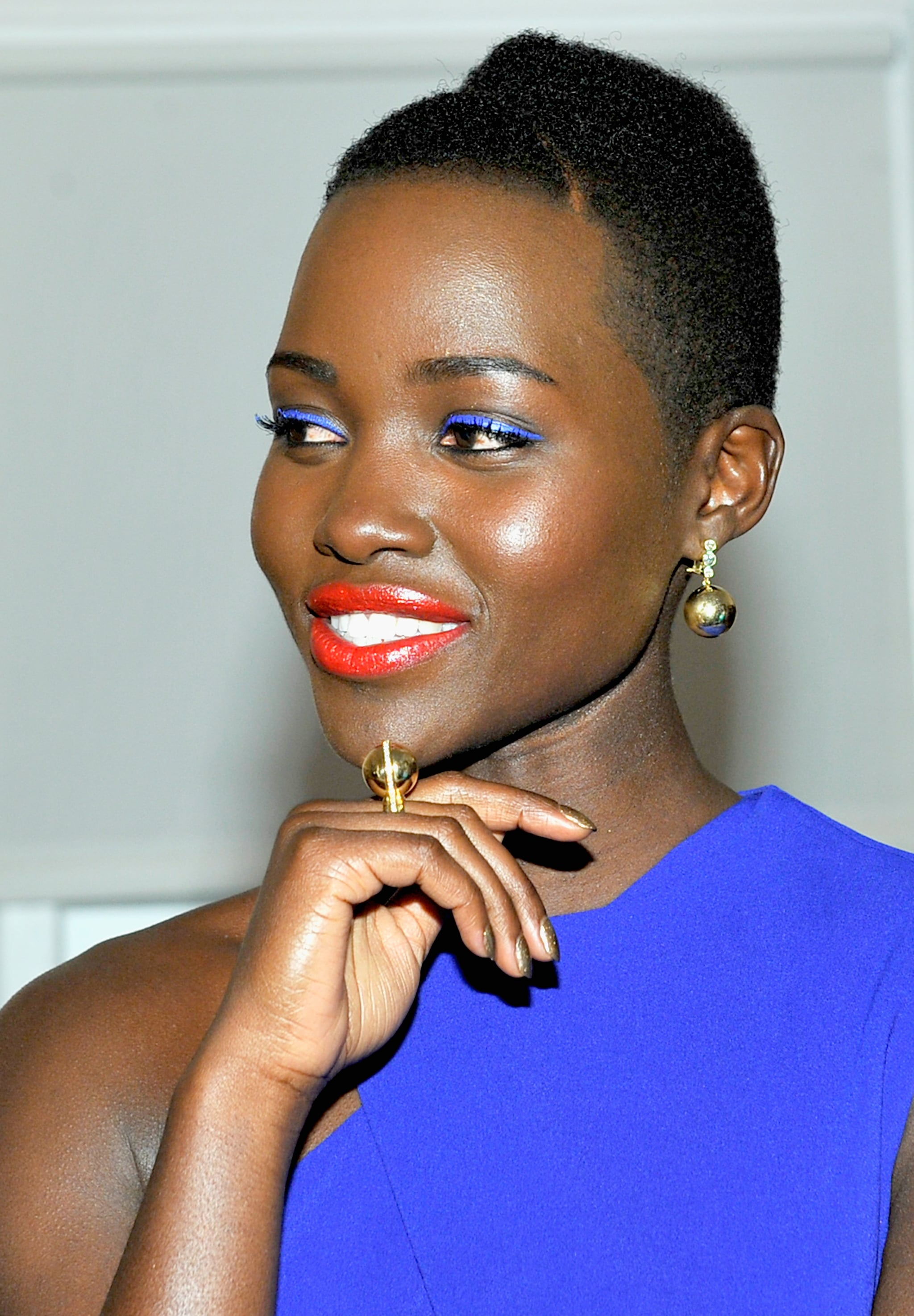 Lupita wore a bold, blue cutout dress to the cocktail party.