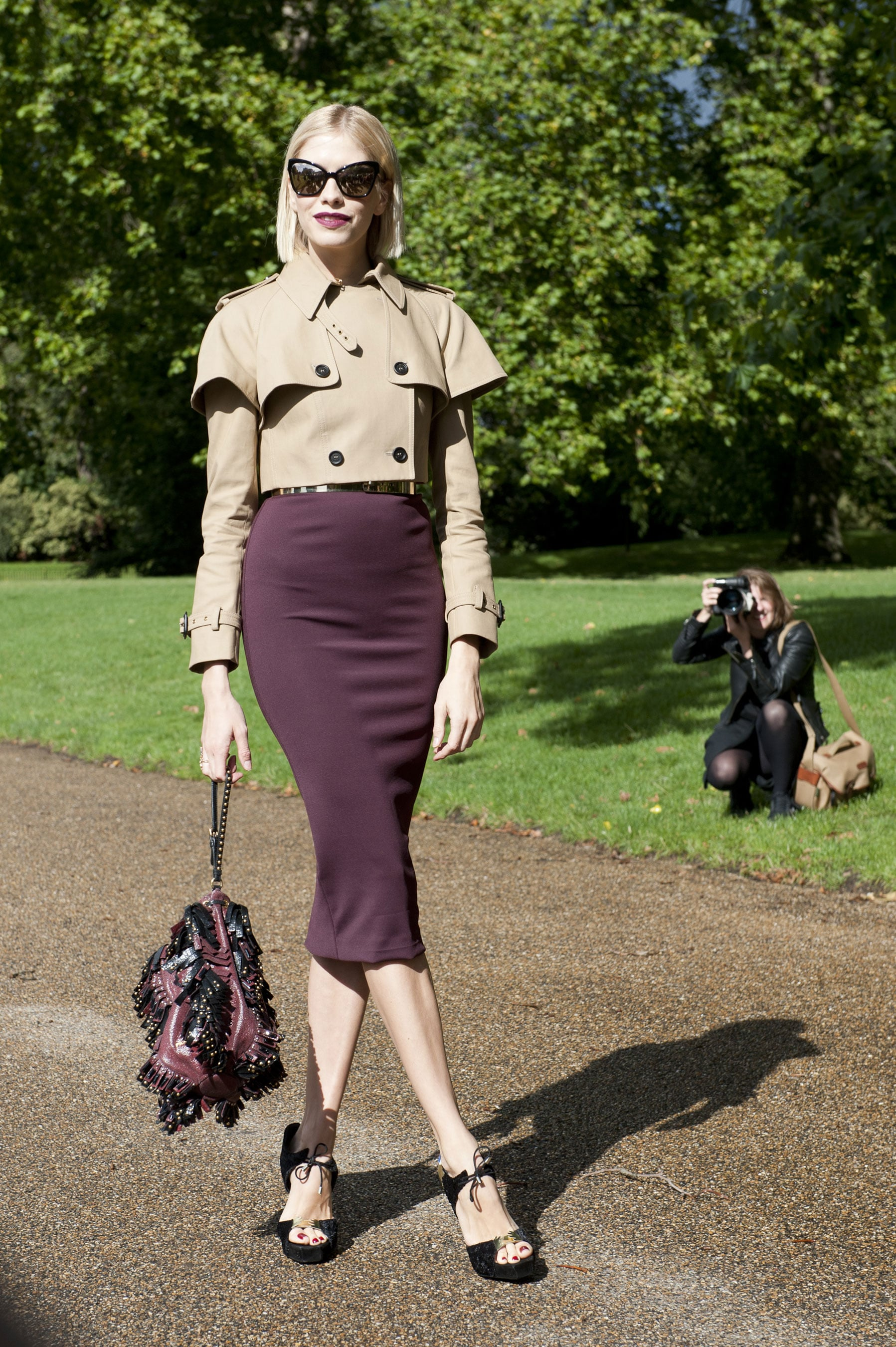 Elena Perminova matched her lipstick to her skirt and topped off the look with a sharp, cropped trench.