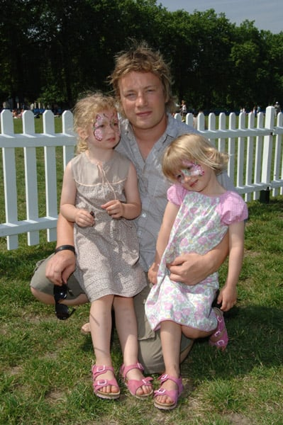 Jamie shows he's every bit the family man, appearing at a local 10K race in London with his two daughters, Poppy and Daisy, in 2006.