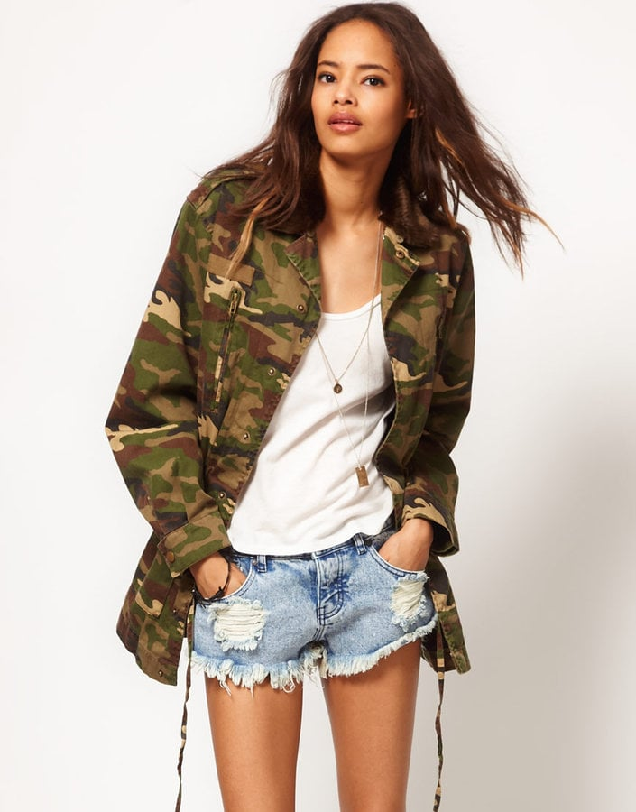 This roomy camo jacket makes us warmer just looking at it. ASOS Army Camo Jacket With Detachable Fur Trim Collar (approx $98)