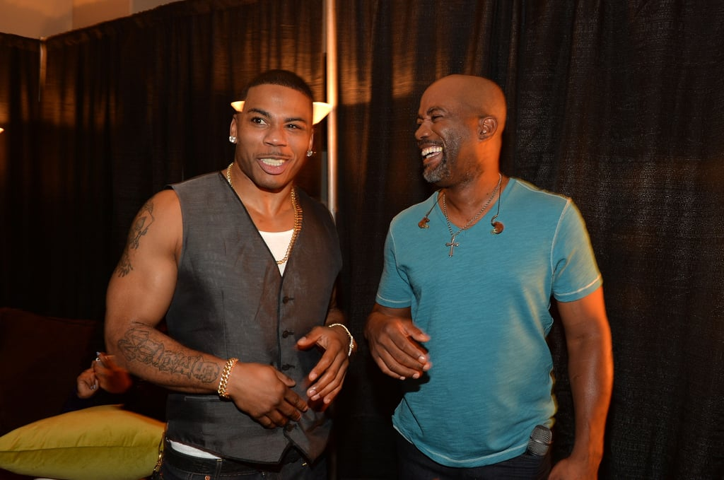 Nelly laughed with Darius Rucker backstage.
