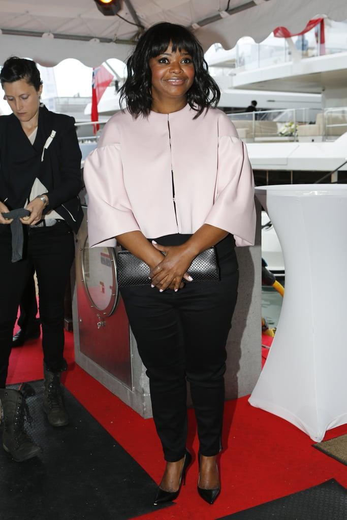Octavia Spencer boarded the yacht in a Tadashi Shoji capelet.