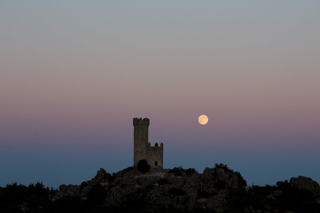 We spy the supermoon behind the Torrelodones Tower in city of Torrelodones, close to Madrid, Spain, on Aug. 10.