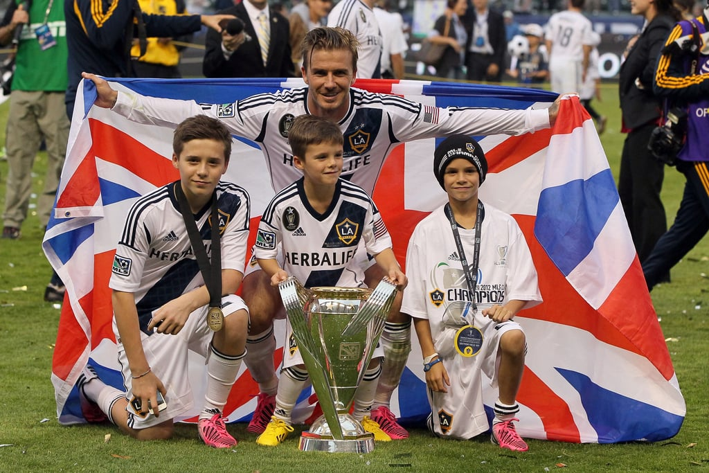 David Beckham's final game with the LA Galaxy ended with his team's winning the MLS Cup, and he celebrated with sons Brooklyn, Romeo, and Cruz.