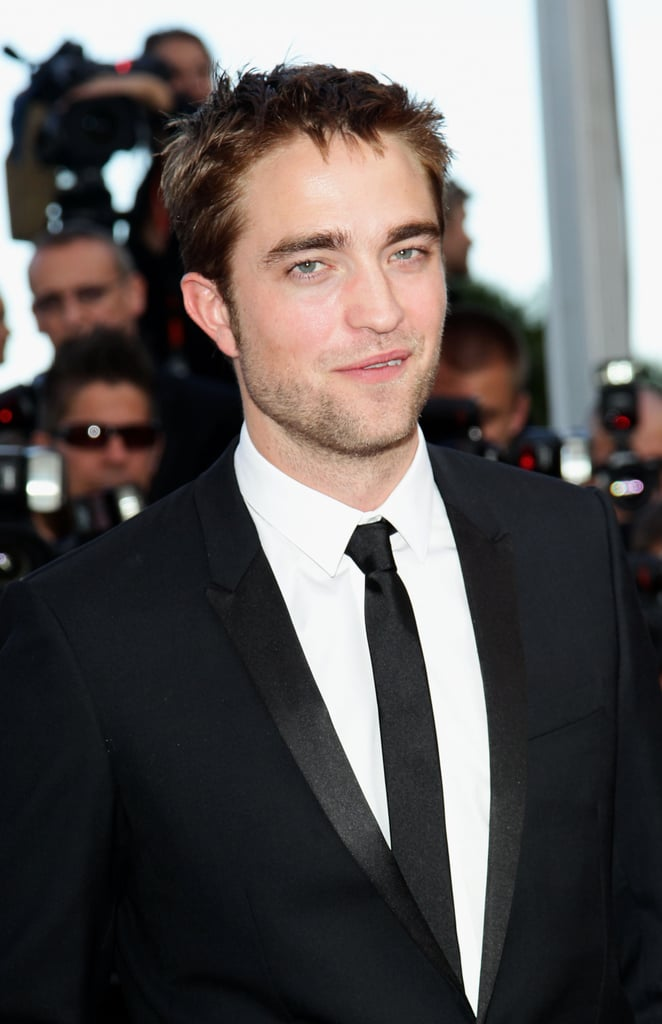 Robert Pattinson gave a smile the red carpet for girlfriend Kristen Stewart's On the Road premiere at the Cannes Film Festival.