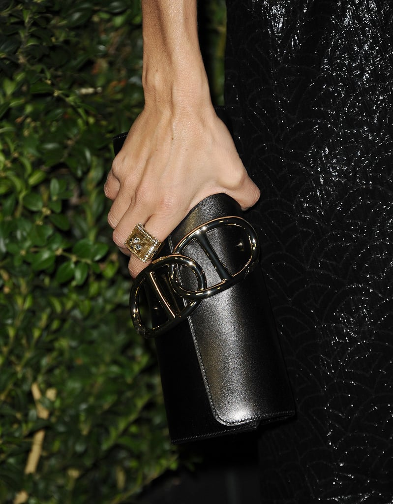Rachel Zoe toted a pewter-hued clutch.