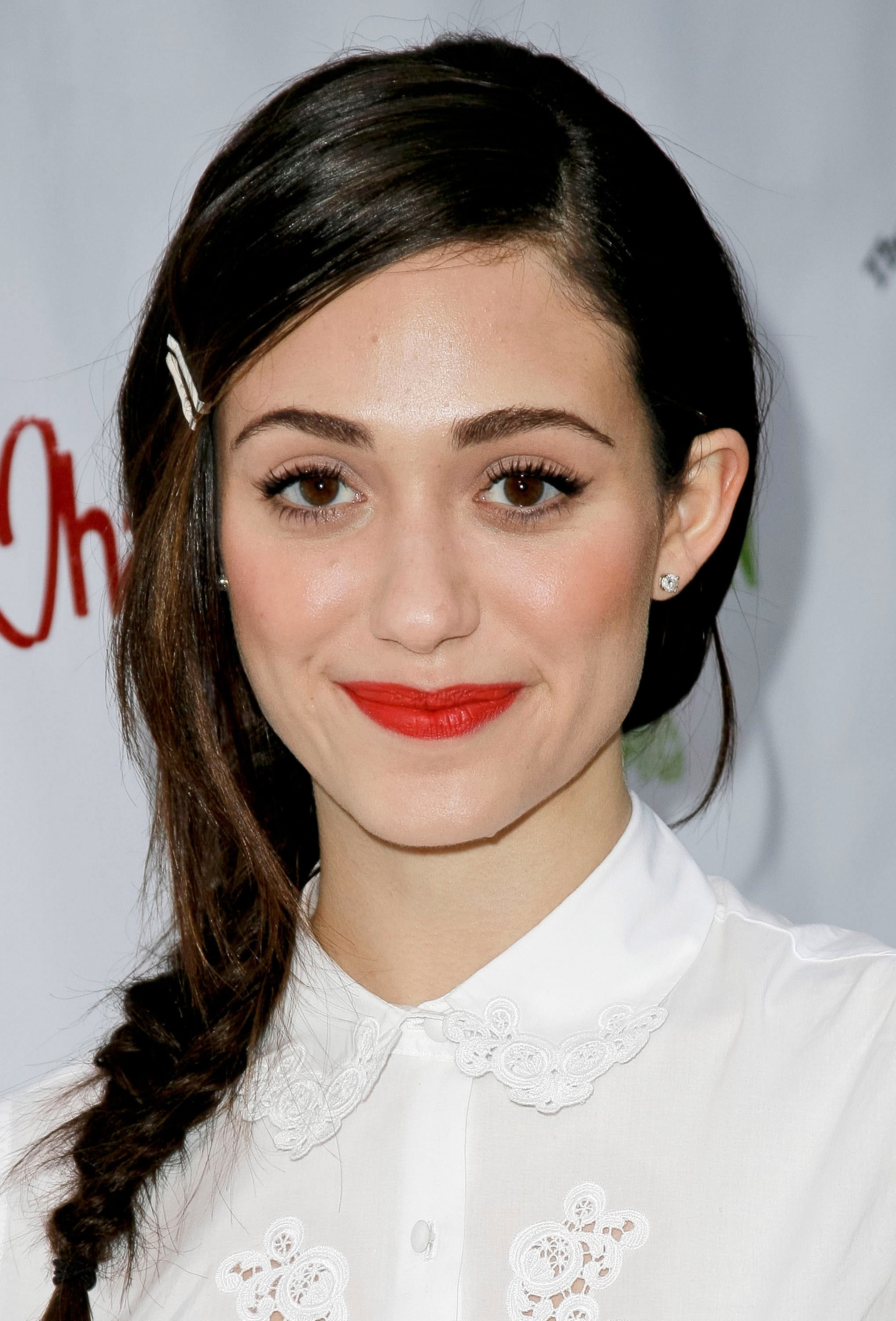 To keep her long layers in line, Emmy Rossum added a couple of white pins to contrast with her dark strands. Paired with a braid, this style is perfect for a Summer brunch, shower, or garden party.