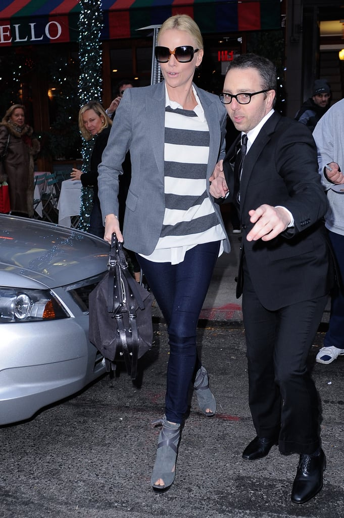 To lighten up a tailored silhouette, just add stripes — Charlize's off-duty attire here showcases it perfectly.