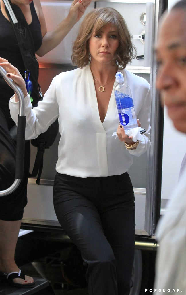 Jennifer Aniston carried a SmartWater bottle on July 17 while leaving a trailer on set.