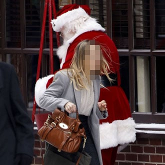 Guess the Celebrity Running Past Santa Claus