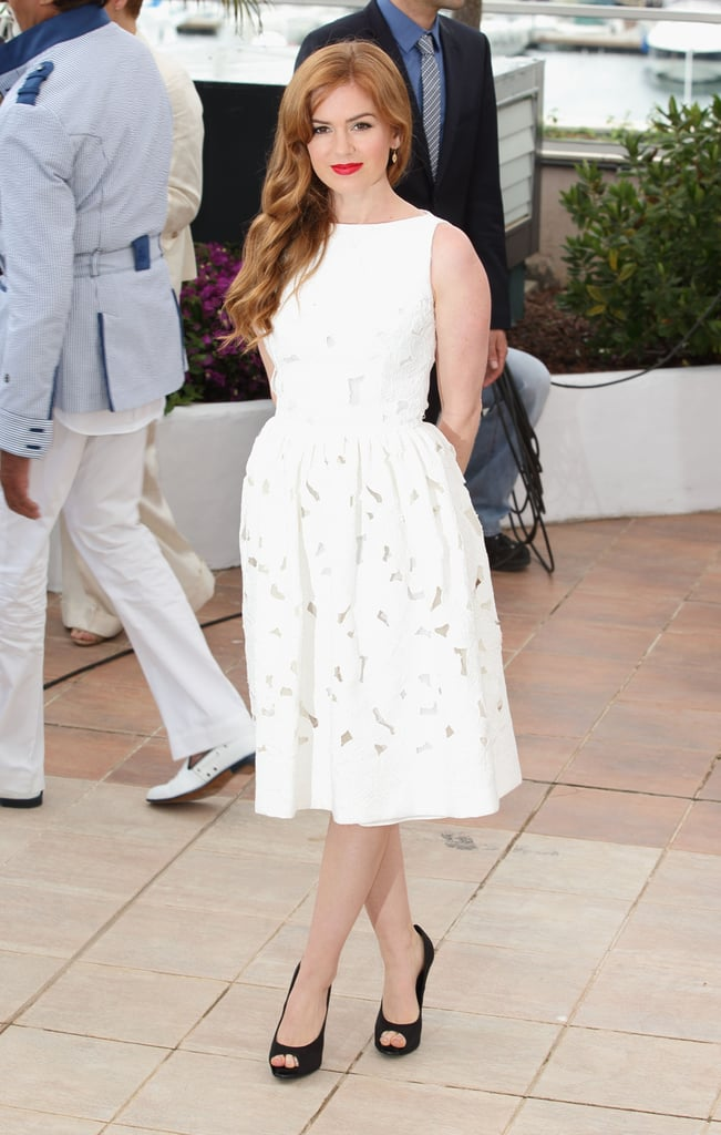 Isla Fisher also attended a photocall for The Great Gatsby in a white Dolce & Gabbana dress with cutout floral details and black peep-toe Roger Vivier pumps.