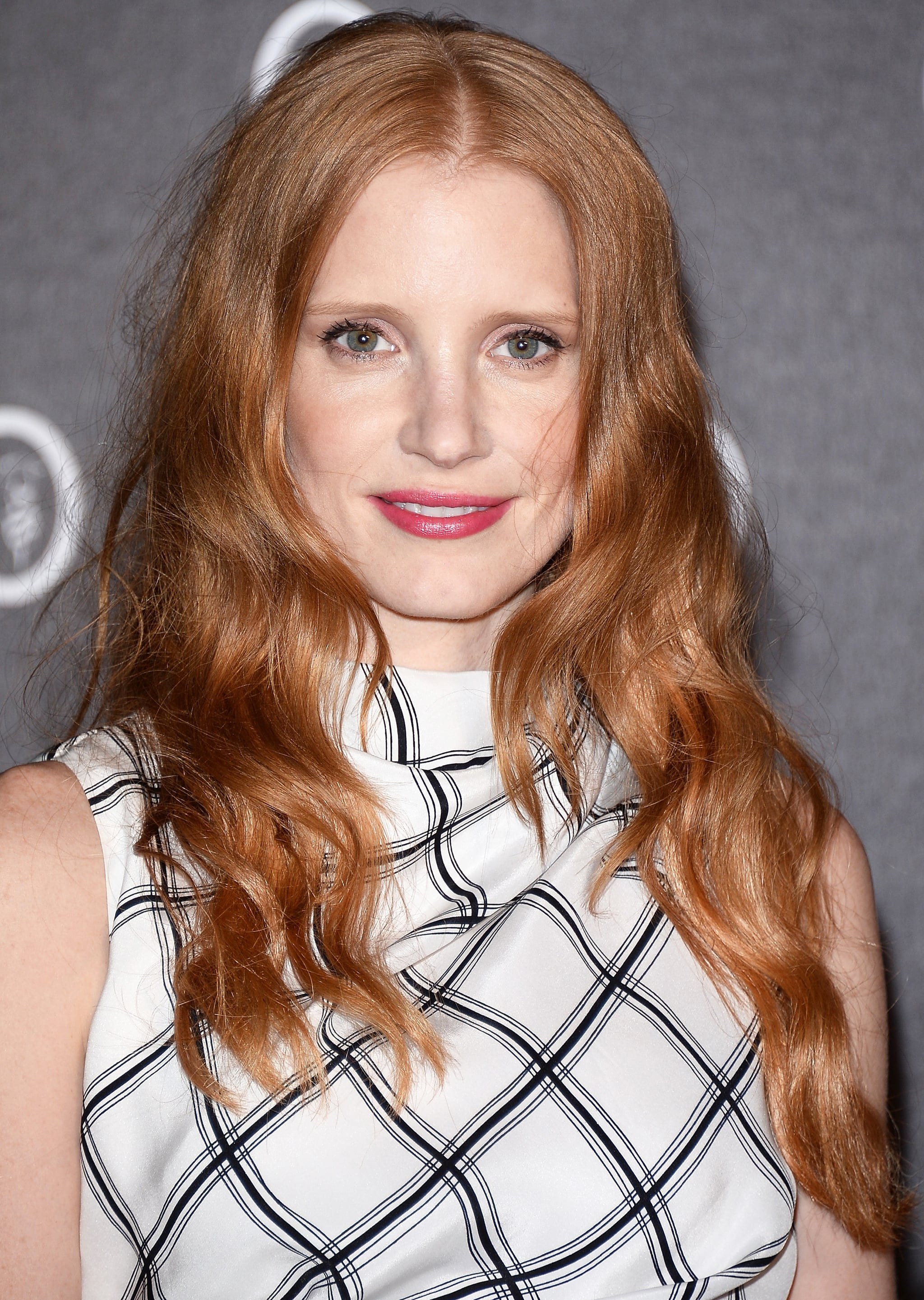 Jessica Chastain was out at a cocktail party in Venice donning polished beach waves with a hint of blush and rose lipstick to accentuate her complexion.