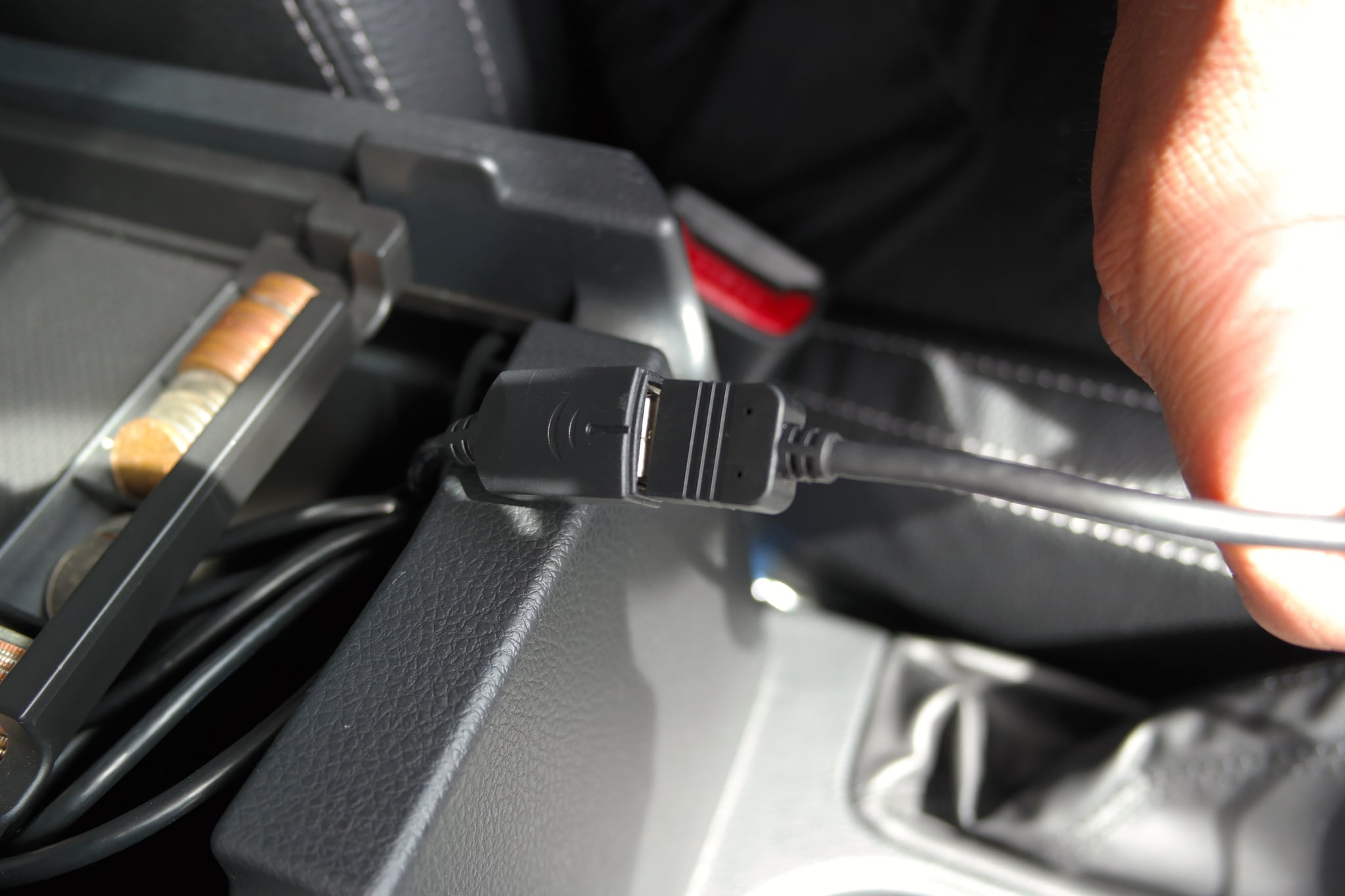 This USB cable is installed into the center console (middle compartment).