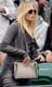 Maria Sharapova hit the Wimbledon bleachers in a cool gray leather jacket, a colorblock bag, and metal-framed sunglasses.