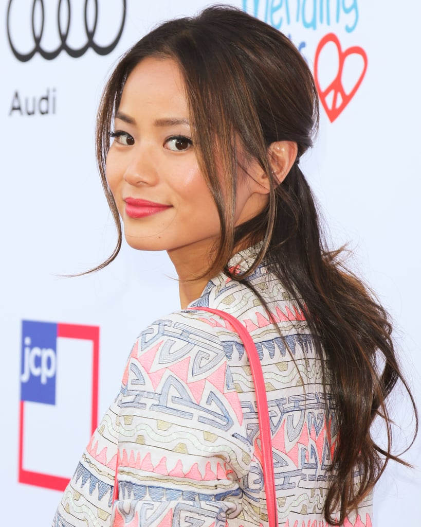 Jamie Chung nails the half-up look by keeping the pulled-back part low at the neck. The wispy tendrils make it even more casual-chic.