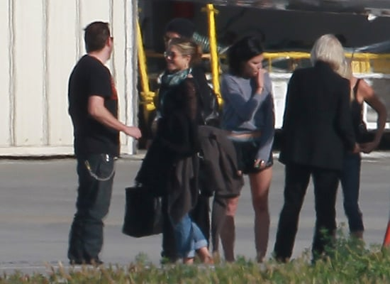 Jennifer Aniston and Justin Theroux said hi to friends in LA.