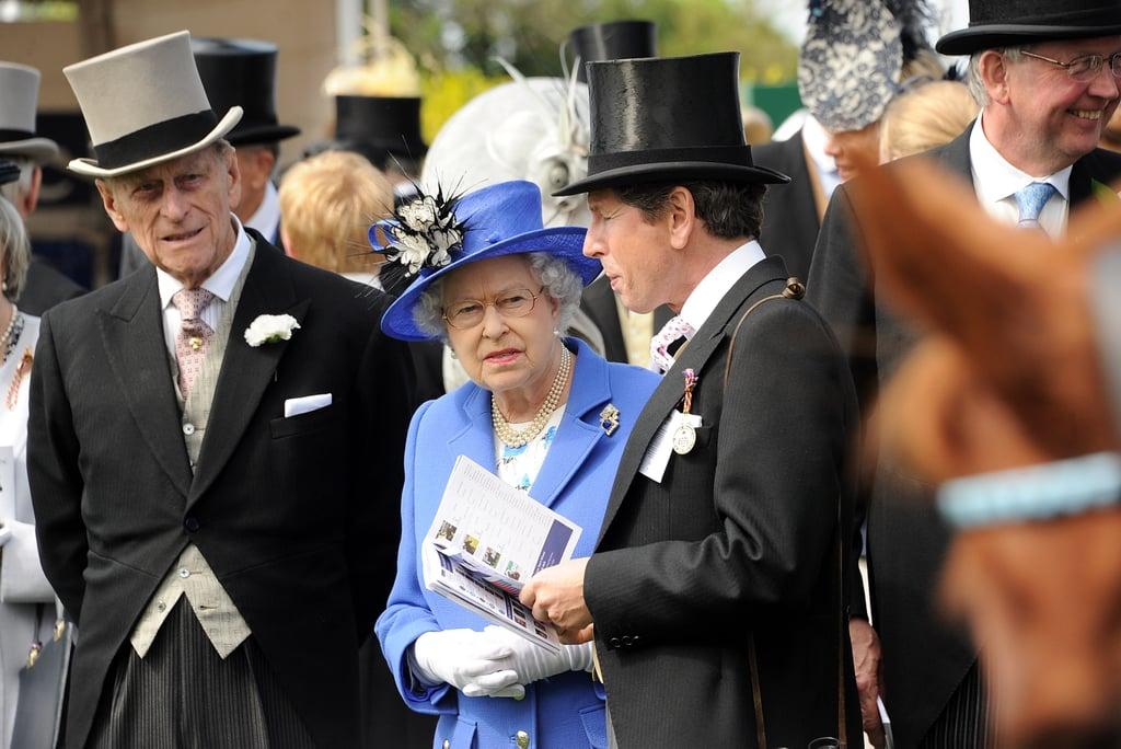 Prince Philip, Duke of Edinburgh; Queen Elizabeth II; and Sir John Warren spoke with one another.