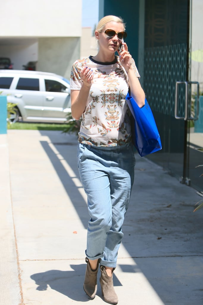 While running errands in LA, Jaime fused laid-back with cute by tucking a printed tee into a pair of light-wash jeans, then finishing with taupe booties with a low heel.