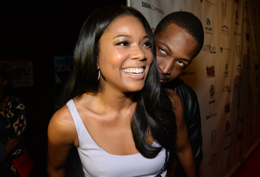 Dwayne and Gabrielle were all cuddles and laughs at a January 2014 party in Miami.