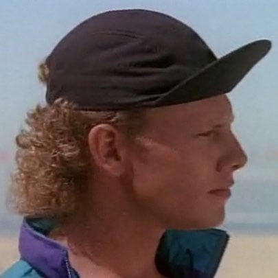 Steve shows off his curly mullet.
